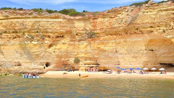 People on a secluded beach getting ready for BBQ