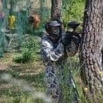 Men hiding behind a tree for Paintball in Albufeira