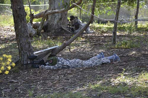 Group hiding in the trees and bushes for paintball in Albufeira