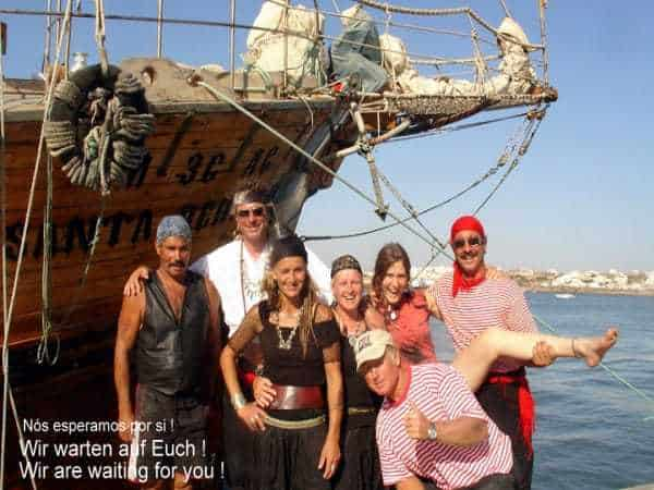 Pirate crew in fornt of the ship