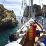 Traditional sailing boat trip with rocks o the side - Alvor